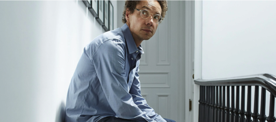 A photo of author and podcaster Malcolm Gladwell